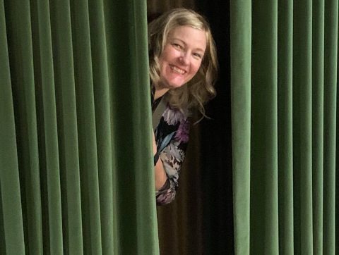 author peeking out of dressing room closet at the Ryman Theater in Nashville, Tennessee